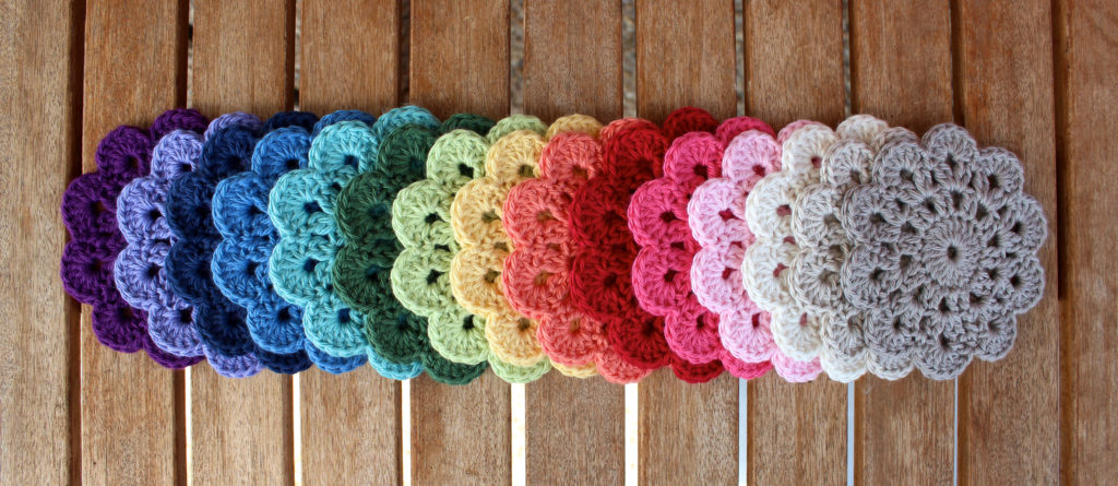 10 petal coasters. Bendigo Woollen Mills 8 ply cotton in Regal, Wild Lavender, French Navy, Sky, Light Teal, Cypress, Honeydew, Daffodil, Peach, Pomegranate, Blush, Pink Rose, Parchment, Latte and Fawn.